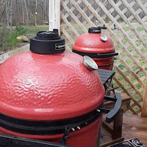 Two kamado grills on deck